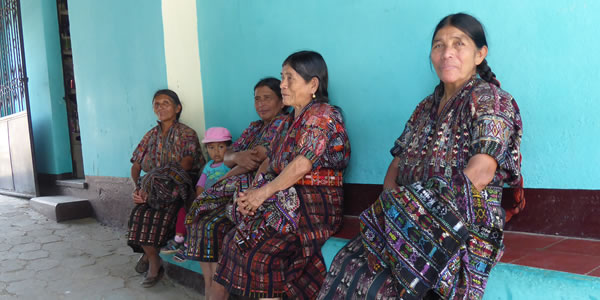 Guatemalan women in colorful dresses