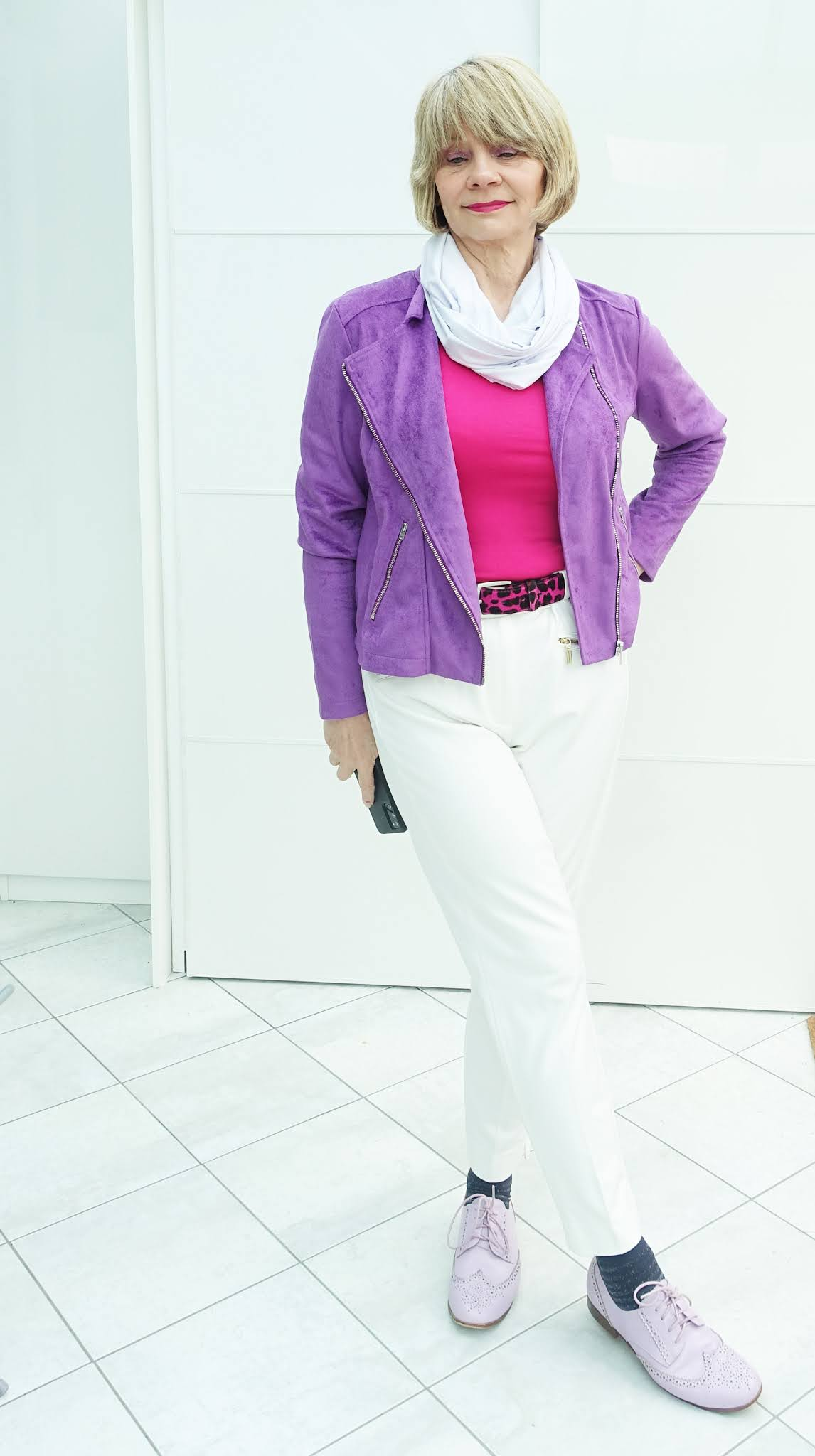 Bright violet suede jacket with white trousers for spring