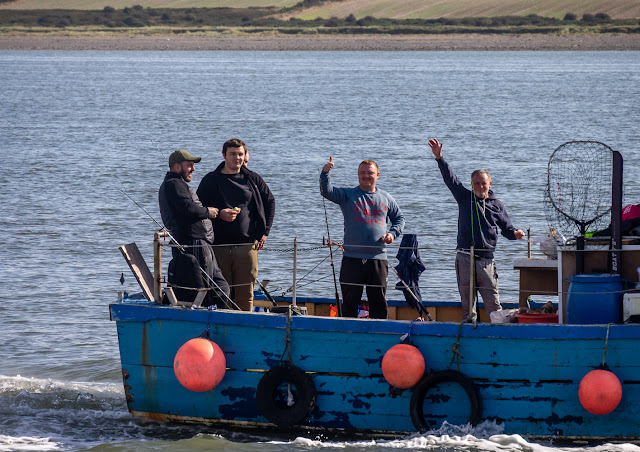 Photo of some of the anglers on Venture West waving to us