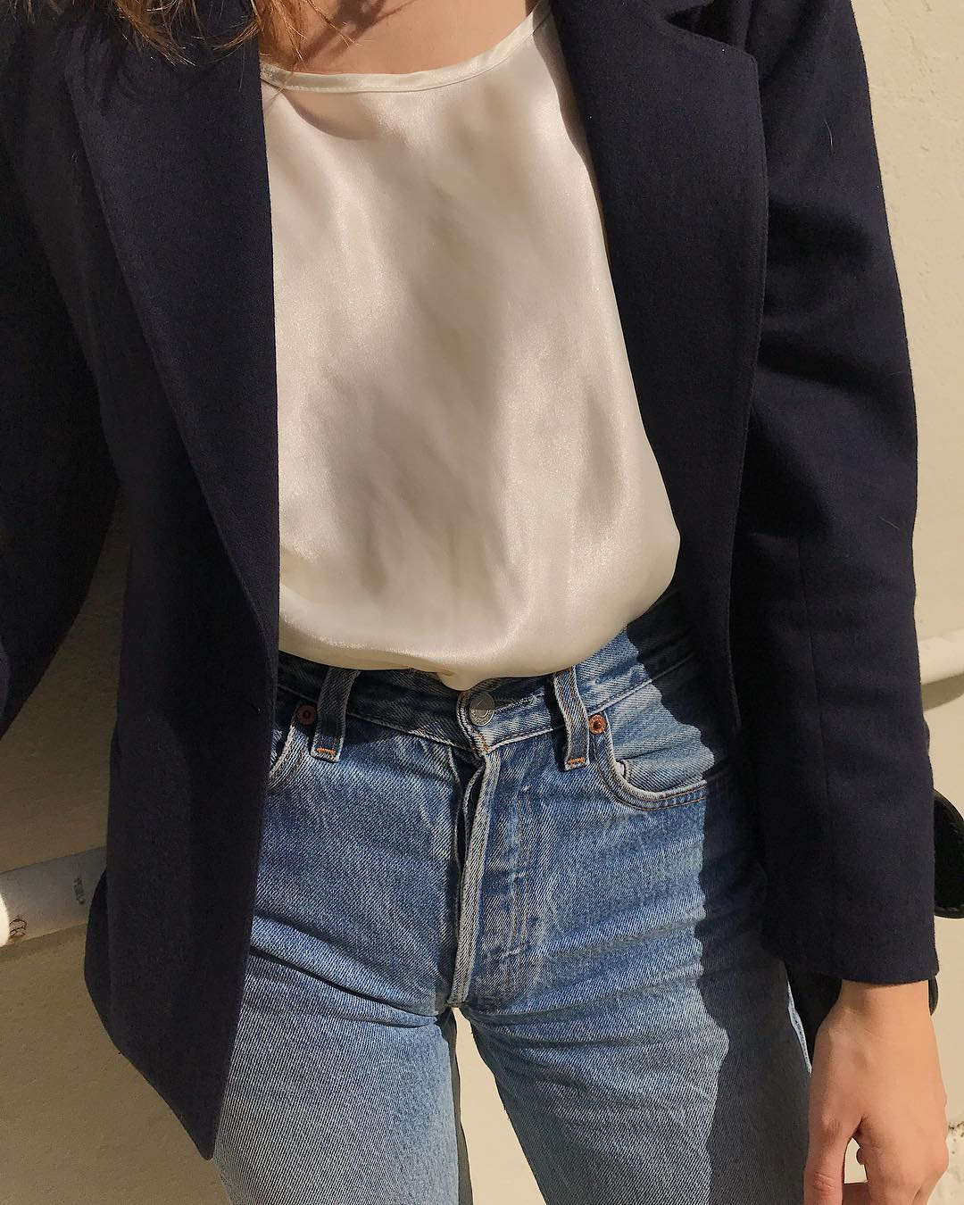 Elevated Spring Outfit Idea —Instagram look with a black blazer, an ivory silk tank top, and classic Levi's jeans