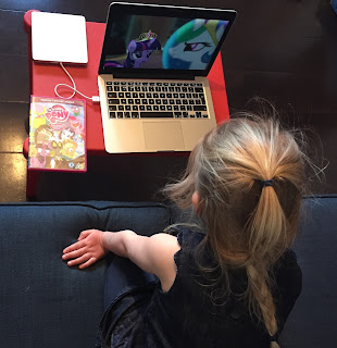 4 year old girl watching DVD intently