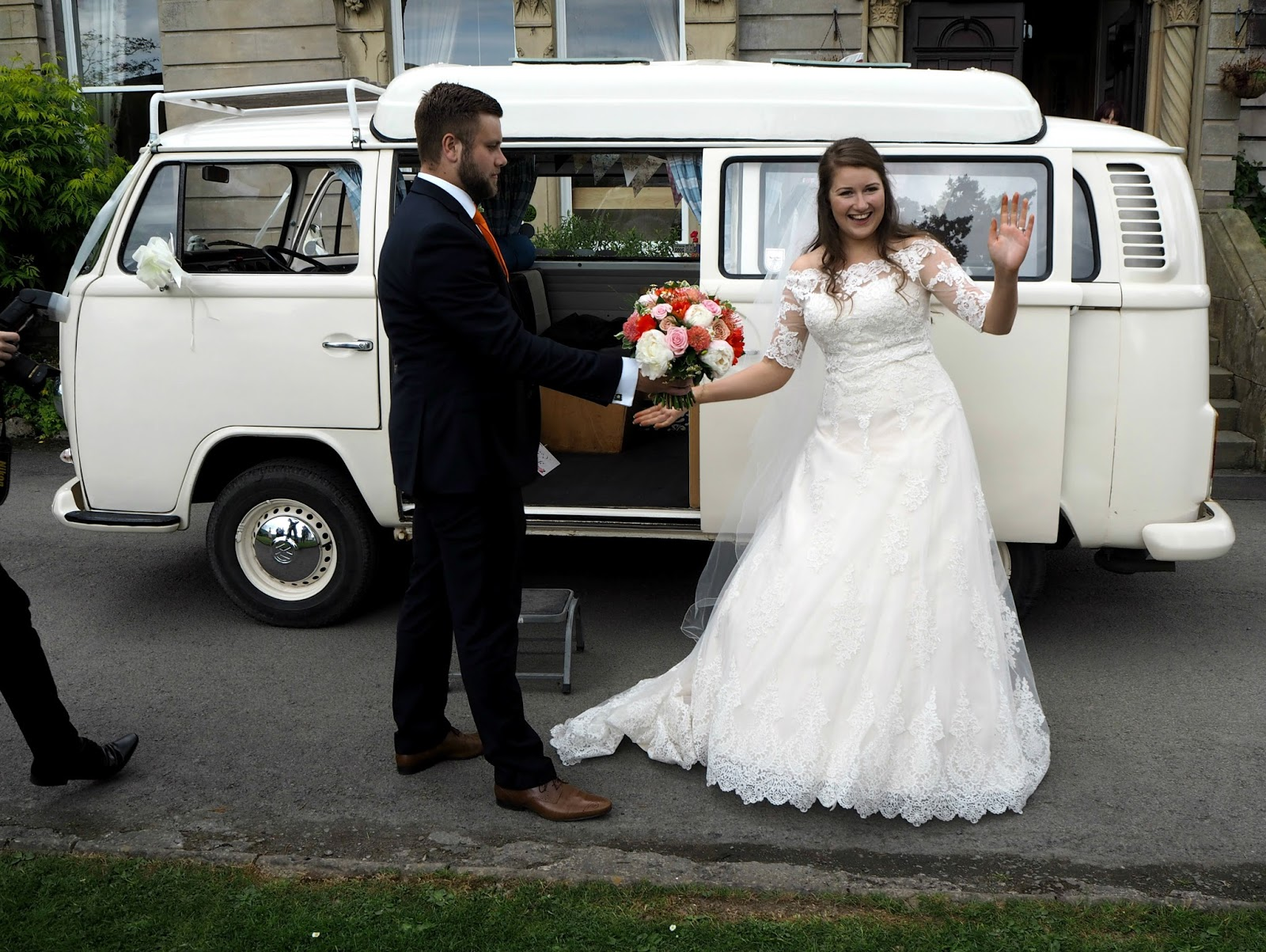 Wedding couple stepping out of campervan