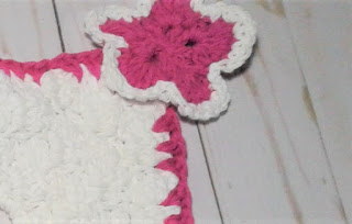 crochet flower on the corner
