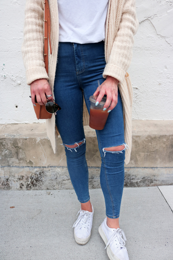 Ripped Blue Jeans White Shoes Brown Bag