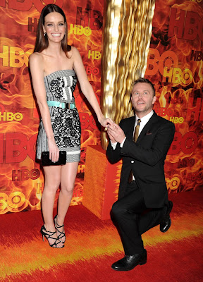 Chris Hardwick gets down on one knee to pretend to propose to his fiancee Lydia Hearst