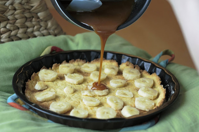 Pour the caramel sauce over the bananas