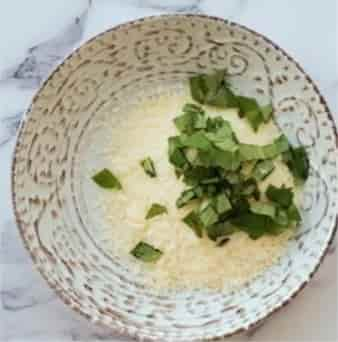 mixing-parmesan-and-basiil-leaves
