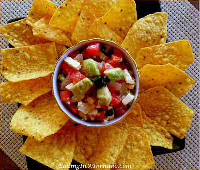 Zesty Avocado Queso Dip, a flavor packed zesty take on Pico de Gallo. Fresh flavors make this dip a hit. Also delicious on tacos or enchiladas. | Recipe developed by www.BakingInATornado.com | #recipe #appetizer #dip