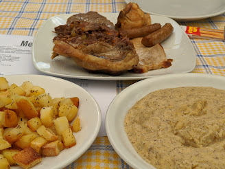 Lunch dish at Merelli Gilberto - Mixed meats with potatoes and polenta taragna.