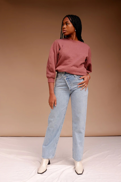 Model in blue jeans and pink sweatshirt from Pipe & Row