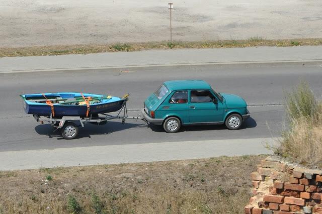 Fiat pulling boat trailer