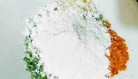Mixing vegetables, flour, paneer for making manchurian balls