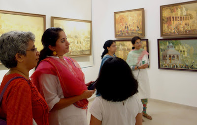 Guests looking at the Banaras show at Indiaart Gallery