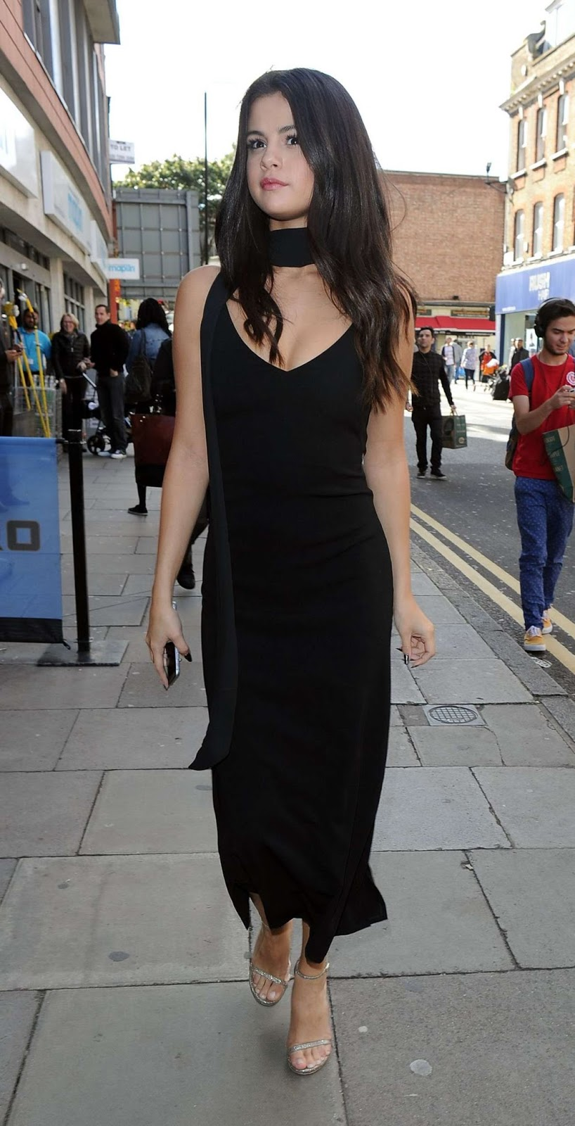 Selena Gomez struts in style in a black dress in London