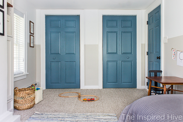 Blue doors. Kids activity table. Train track toys.