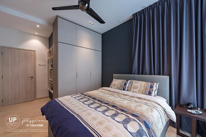 royal regent condo bedroom in dark blue wall paint and fabric texture wardrobe