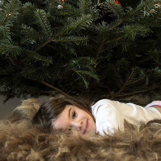child under real Christmas Tree
