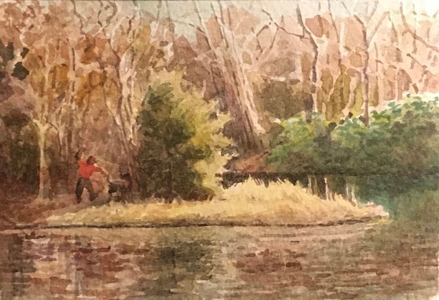 Watercolor painting of park scene with sunlight falling on yellowish grass against dark woods and green laurel bushes. A man in a red jacket is throwing a ball for his dog. Scene is reflected in gently rippling lake water.