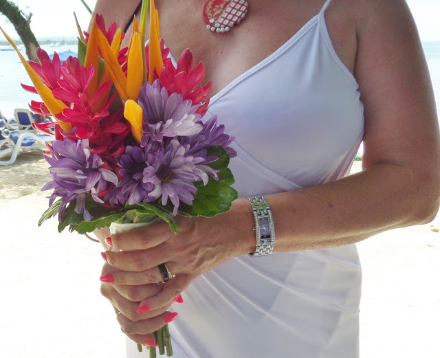 bride holding tropical bouquet