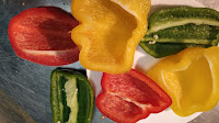 Half of red, yellow and green bell pepper for paneer Tikka