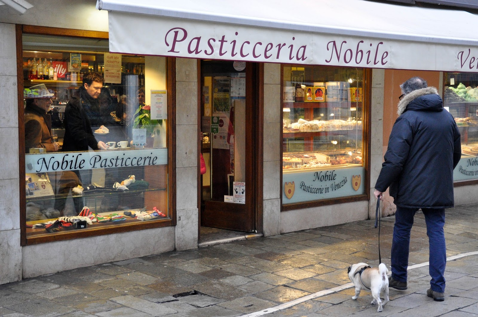 A man and his dog heading to the patisserie, Venice, Italy