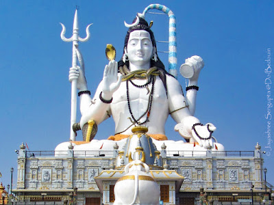 The Shiva statue and the surrounding replicas of the Char Dham in front of it.