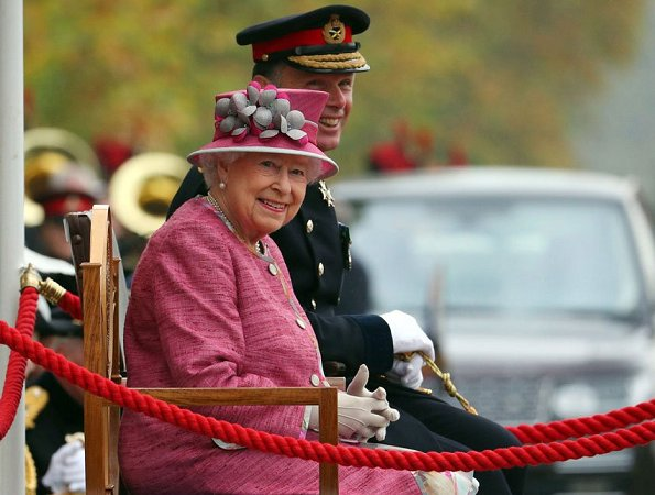 Britain's Queen Elizabeth II at the Hyde Park. Style of Queen Elizabeth, Fashion pink coat, dress, and clutch bag