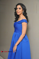 Actress Ritu Varma Pos in Blue Short Dress at Keshava Telugu Movie Audio Launch .COM 0080.jpg