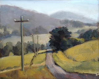 Landscape oil painting of a road leading to some trees and distant hills, with several telephone poles.