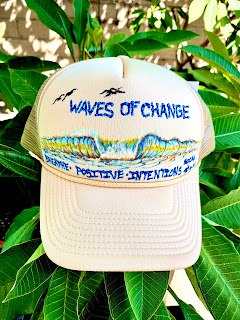 Custom painted hats by Paul Carter