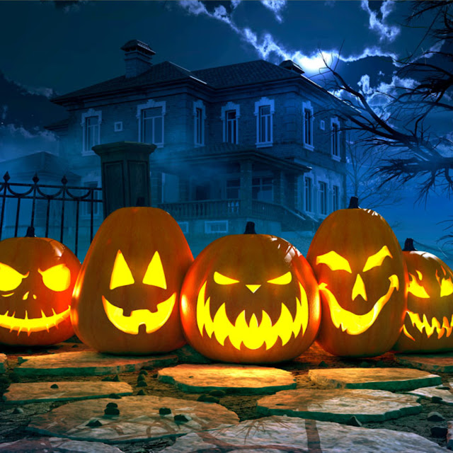 jack-o-lanterns in front of a spooky house