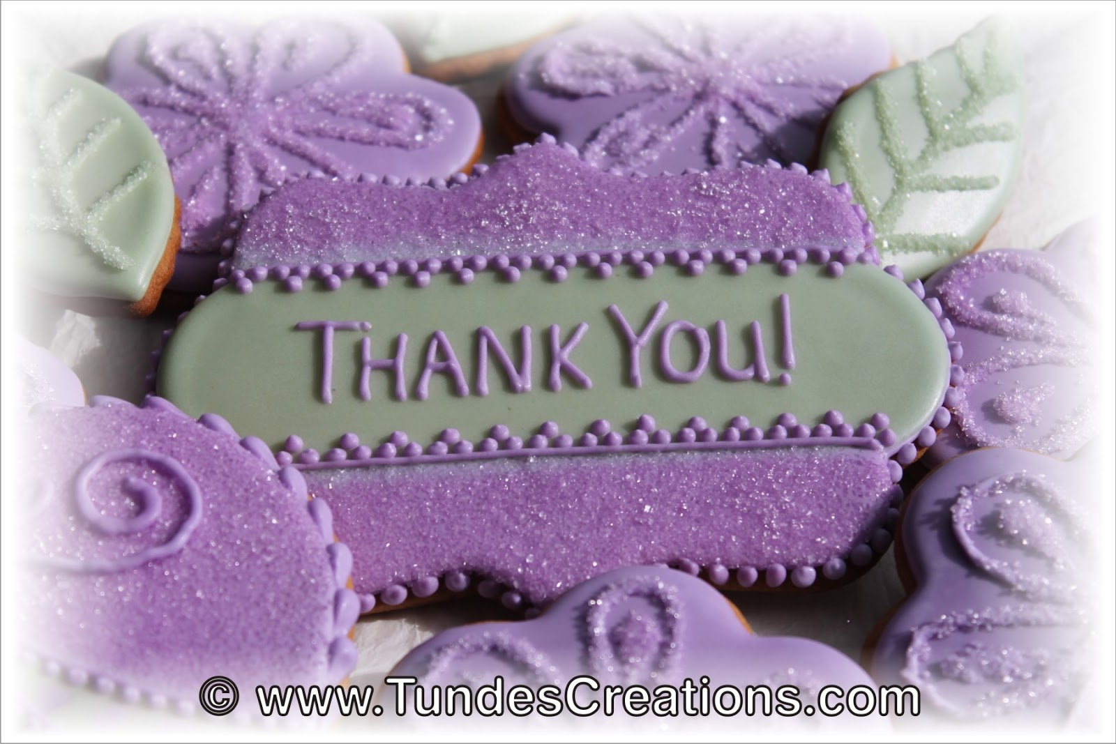 the gingerbread artist purple flower quotthank youquot cookie
