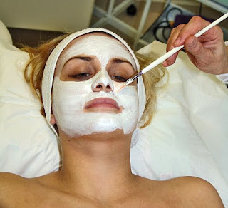 a woman having a facial
