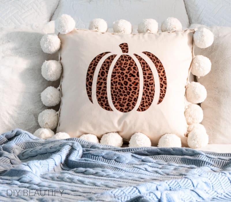 cheetah print pumpkin pillow with pom poms