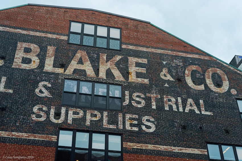 Portland, Maine USA June 2019 photo by Corey Templeton. WL Blake and Co old timey sign on Commercial Street brick building.