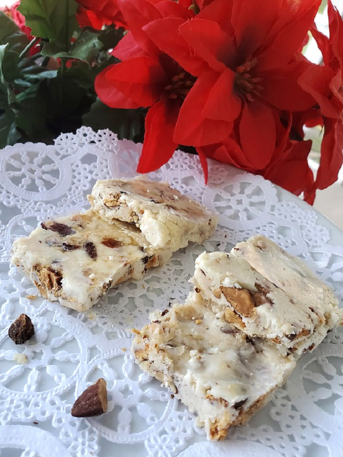 this torrone on a plate for christmas it has roasted almonds in a nougat style confection