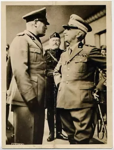Mussolini, another reactionary populist, with the king who appointed him into power