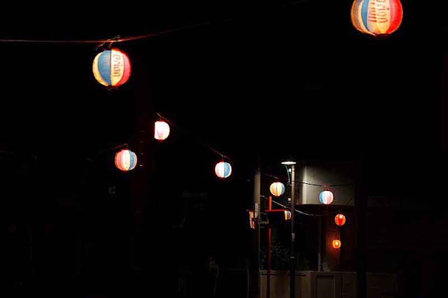 Orion Beer, paper lanterns,night street scene