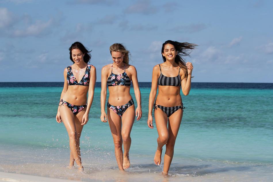 three ladies in bikinis