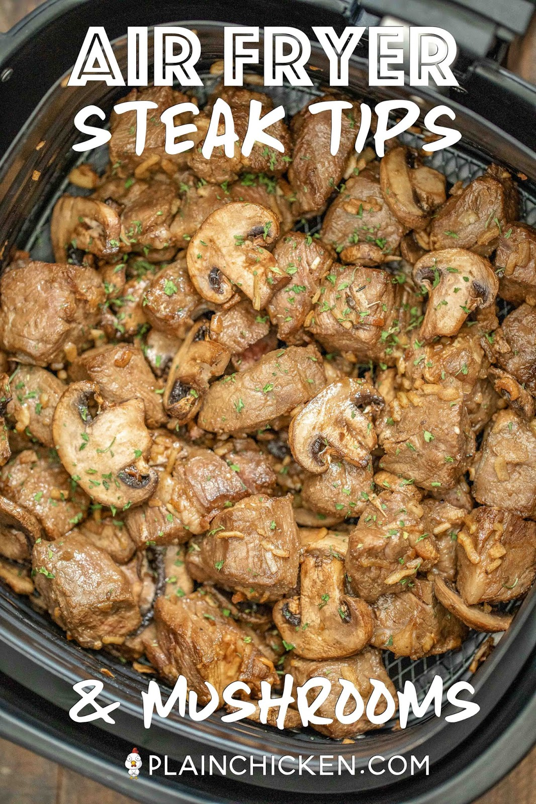 cooked steak tips and mushrooms in air fryer basket