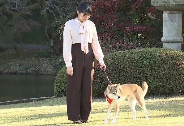 Japanese Princess Aiko wore a pink pussy-bow silk blouse. Princess Aiko with her dog Yuri at Akasaka