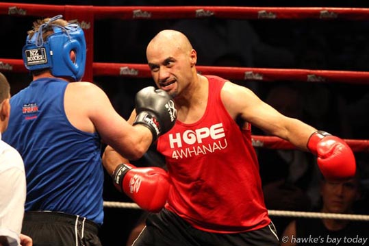 "Split decision to the red corner. Heath Clark (red) vs Simon McFarland ""The Ice Man"" (blue) - Hope 4 Whanau charity boxing event at Pettigrew.Green Arena, Taradale, Napier. photograph"
