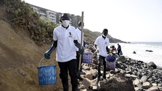 In Senegal's capital Dakar, volunteers clean beach littered with medical waste