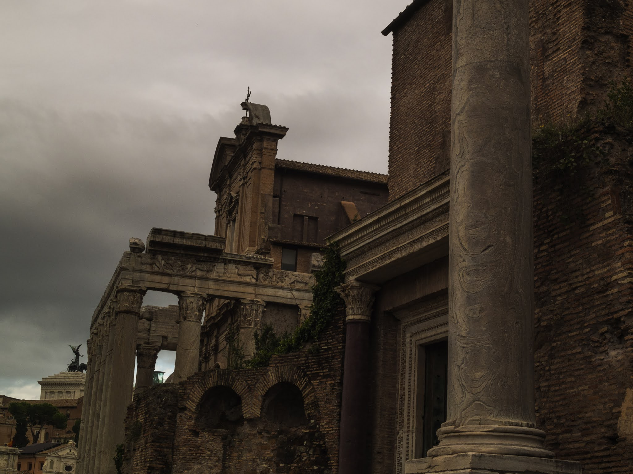 Side view of the temple of Romulus and Remus, and temple of Antoninus and Faustina in the Roman Forumm