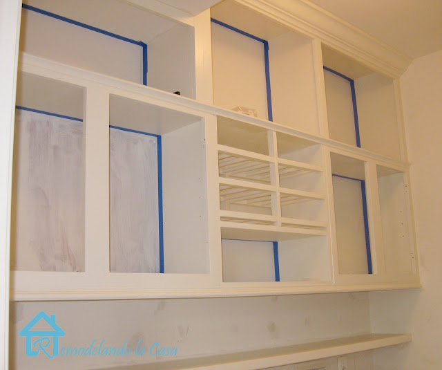 short cabinets in laundry room brought all the way up