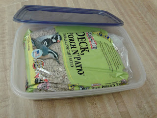 Photo of bird seed bag in storage container