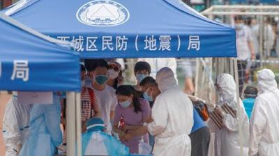 Nuevos contagios por covid-19, inundaciones y extrañas nevadas golpean China