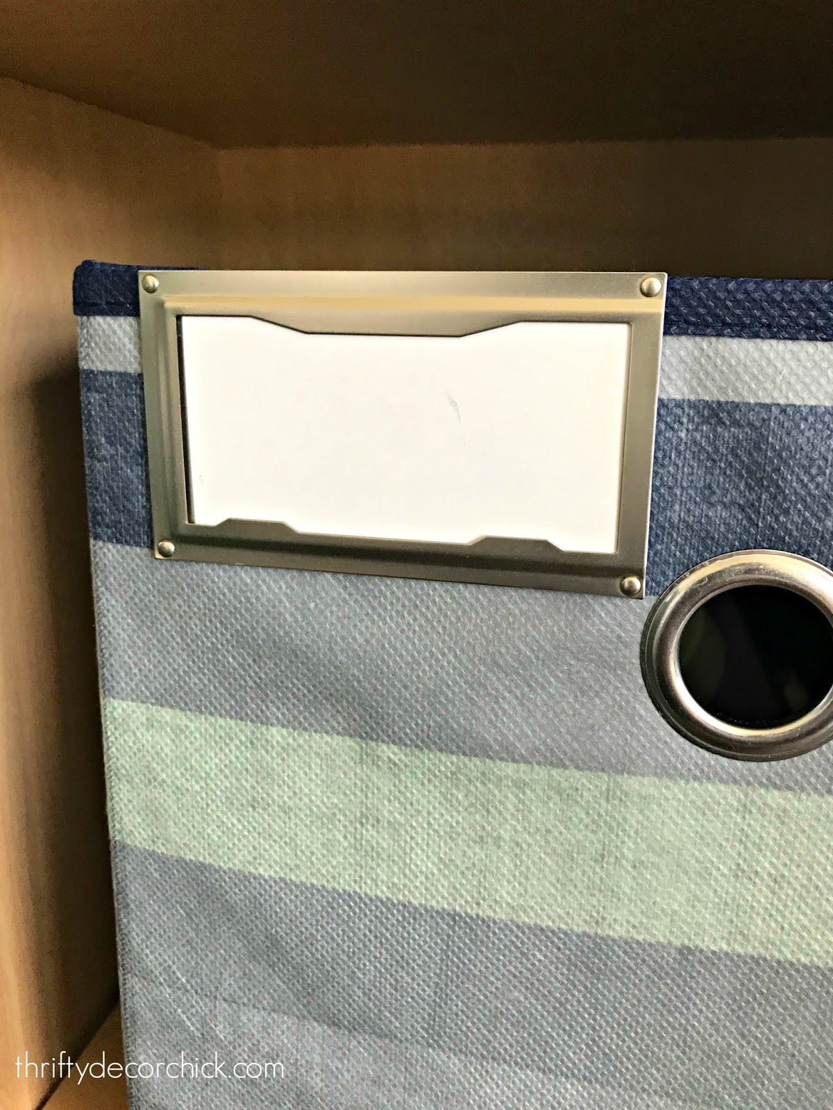 Clip on labels for fabric bins