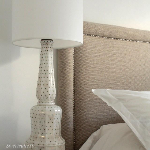Newly refinished headboard next to vintage lamp