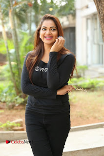 Actress Aswini Latest Stills in Black Denim Jeans  0164.JPG